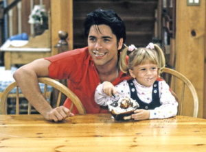 "UNITED STATES - NOVEMBER 05: FULL HOUSE - ""Gotta Dance"" - Season Five - 11/5/91, Jesse (John Stamos) bribed Michelle (Mary Kate/Ashley Olsen) with ice cream to reveal Rebecca's plans., (Photo by ABC Photo Archives/ABC via Getty Images)"